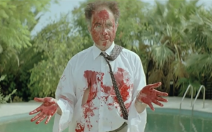 Man covered in blood from Dogtooth